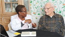Stratford VNA discussing meds with a home care patient